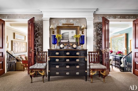 -from Architectural Digest The entrance hall of Hampton's Manhattan home is lined in Gracie wallpaper.