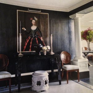 High gloss black walls match a Baccarat black console table in this dramatic entryway decorated by Mr. Langham.
