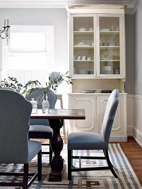 -from Garden & Gun. Barbara Westbrook's dining room features a French bakery cabinet and a lot of light.